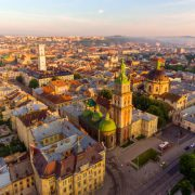 Flying over Lviv City, Ukraine. Town Hall, the tower, Dominican church. Panorama of the ancient city. The roofs of old buildings